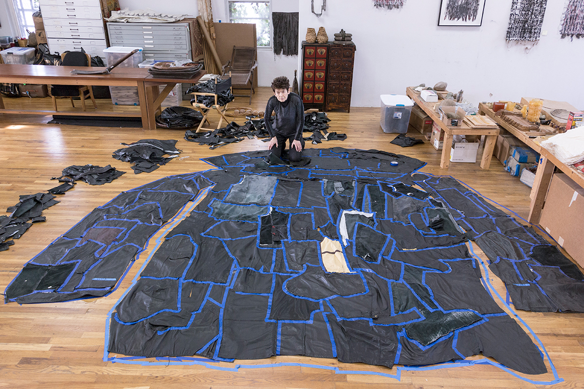 Ursula von Rydingsvard working in her studio in Brooklyn, PODERWAĆ, 2017; Leather, cotton, steel, and polyester batting, 10 ft. 9 in. x 8 ft. 6 in. x 3 ft. 9 in.; In collaboration with The Fabric Workshop and Museum, Philadelphia; © Ursula von Rydingsvard, Courtesy of Galerie Lelong & Co.